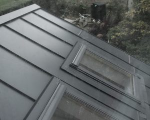 Builder in Sheffield installing steel roof with Velux windows