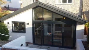 Steel roof rear extension with bifold doors creating a large family living space.