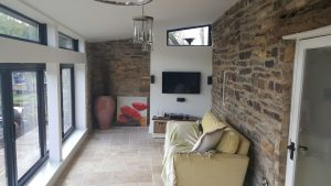 Sheffield farm house stone conservatory with bi-fold doors